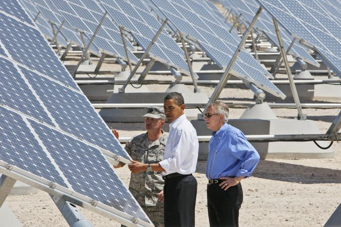 President Obama, accompanied by Senate Majority Leader Harry Reid (right), Nevada Democrat, and Col. Howard Belote, looks at solar panels at Nellis Air F