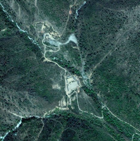 ** FILE ** This satellite image provided by DigitalGlobe and collected on Thursday, May 14, 2009, shows the area in which North Korea reportedly conducted an underground nuclear test on Monday, May 25, 2009, located about 50 miles northwest of the northern city of Kilju, North Korea, Russian Defense Ministry spokesman Alexander Drobyshevsky said on state-run Rossiya television. (AP Photo/DigitalGlobe)