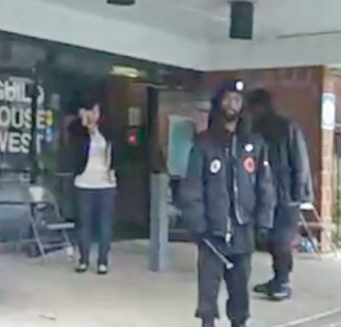 **FILE** Members of New Black Panther Party carrying nightsticks stand outsid