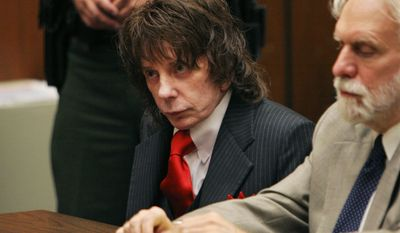 **FILE** Music producer Phil Spector (center) and his attorney Dennis Riordan appear in a courtroom for Spector's sentencing in Los Angeles on May 29, 2009. Spector was sentenced to 19 years to life in prison for the murder of actress Lana Clarkson. (Associated Press)