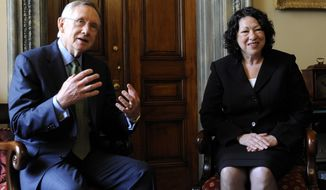 Supreme Court nominee Sonia Sotomayor meets with Senate Majority Leader Harry Reid of Nev. on Capitol Hill in Washington, Tuesday, June 2, 2009. (AP Photo/Susan Walsh)
