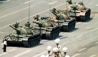 Associated press A Chinese man stands in front of tanks heading down Cangan Boulevard, past the Beijing Hotel, near Tiananmen Square in Beijing on June 5, 1989. The man was pulled away by bystanders, and the tanks continued.
