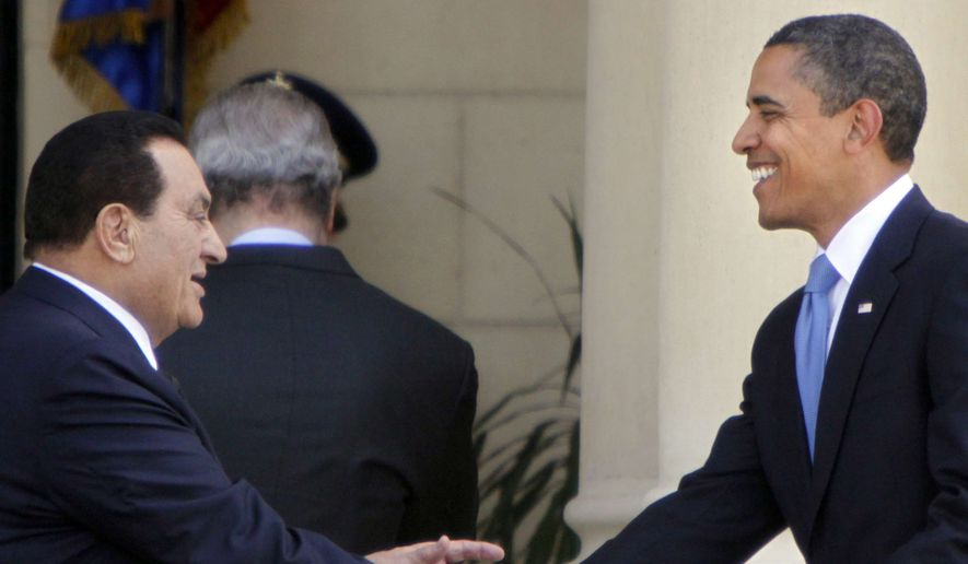 Egyptian President Hosni Mubarak, left, greets U.S. President Barack Obama upon his arrival at Qubba palace in Cairo, Egypt, Thursday, June 4, 2009. President Obama is due to address the Muslim world in a speech during his visit to Egypt. (AP Photo/Amr Nabil)