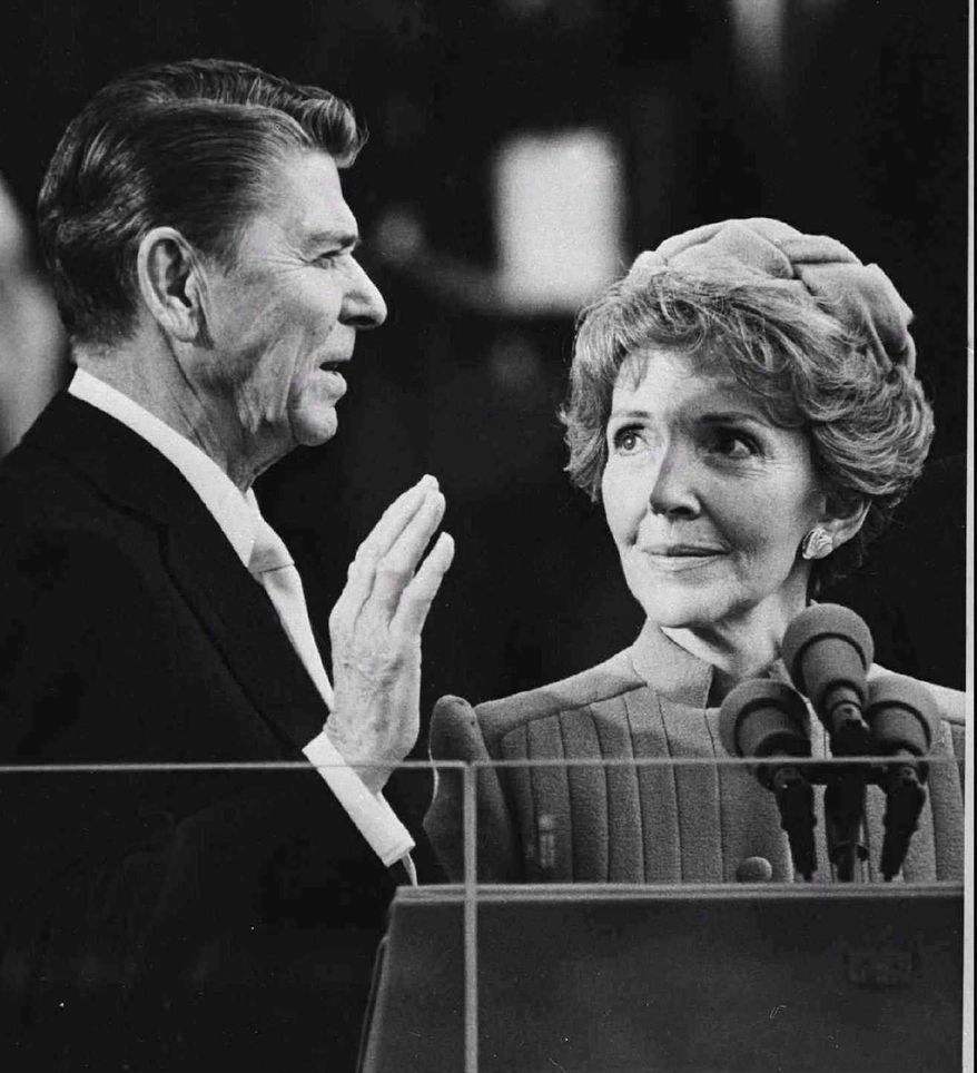 Ronald Reagan, attended by his wife, Nancy, is sworn in as the 40th president of the United States on Jan. 20, 1981, with a vow to ferret out waste and mismanagement in the federal government. (AP Photo)