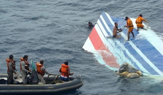** FILE ** Brazilian sailors recover debris from the missing Air France Airbus jet in the Atlantic Ocean in June 2009 in this photo released by the Brazilian air force. (AP Photo)
