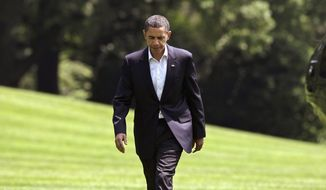 President Barack Obama returns to the White House following a trip to Normandy for a D-Day commemoration and Egypt where he delivered a speech outlining his vision for relations with the Muslim world, Sunday, June 7, 2009. (AP Photo/J. Scott Applewhite)
