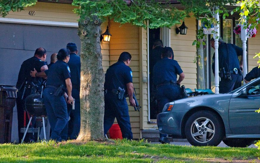ASSOCIATED PRESS PHOTOGRAPHS Tribal police officers (above) raid a home for drugs last month in the Oneida Indian Nation in a joint operation with Wisconsin state authorities. The Wisconsin Justice Department has quietly coaxed tribes to band together against rising crime on reservations. An Oneida police officer (below) arrests a suspect on drug charges.