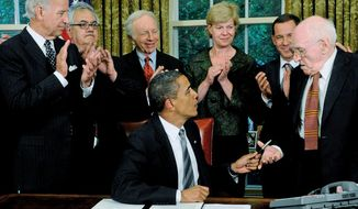 Mary f. Calvert/the Washington Times ONE STEP: Gay rights activist Frank Kameny (right) joins President Obama, his team and other gay rights activists as the president signed a memorandum to expand benefits to gay partners of federal workers.