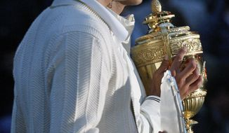 Rafael Nadal (R) and Roger Federer of Switzerland hold their respective trophies after Nadal beat Federer 6-4, 6-4, 6-7, 6-7, 9-7, in the Men's Singles Final during the 2008 Wimbledon Championships at the All England Tennis Club in south-west London, July 6, 2008. AFP PHOTO/CARL DE SOUZA (Photo credit should read CARL DE SOUZA/AFP/Getty Images)