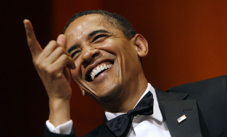 President Barack Obama laughs during the beginning of the Radio and Television Correspondents Dinner, Friday, June