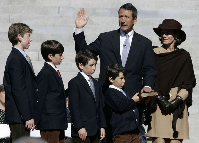 ** FILE ** South Carolina Gov. Mark Sanford takes the oath of office for a second term with his wife, Jenny, and sons (from left) Marshall III, Landon, Bolton and Blake during inaugural ceremonies at the Statehouse in Columbia, S.C., on Jan. 10, 2007.  (AP Photo/Mary Ann Chastain)