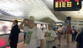 **FILE ** Passengers await a Red Line train at Metro's Metro Center station in Washington. (AP Photo/Harry Hamburg)