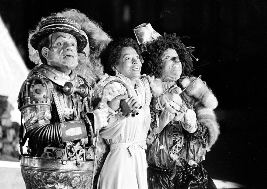 "In this Oct. 4, 1977 file photo, Diana Ross, center, as Dorothy, Michael Jackson, right, as Scarecrow, and Nipsey Russell as Tinman perform during filming of the musical ""The Wiz"" in New York.  Ted Ross, portraying the Lion, is partly hidden behind Russell.  (AP Photo, file)"