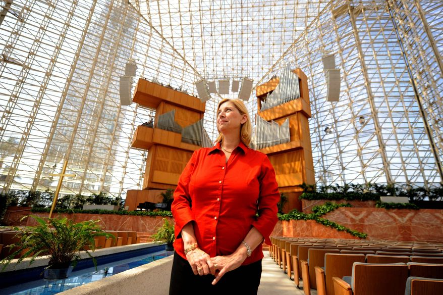 ** FILE ** The Rev. Sheila Schuller Coleman stands in the Crystal Cathedral, which her father, the Rev. Robert H. Schuller, built in Garden Grove, Calif. (AP Photo)