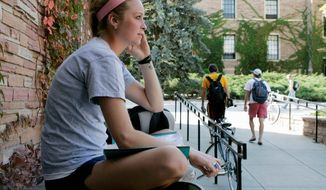 **FILE** Madelaine O'Neal, a freshman from St. Louis, Mo., studies outside the book store at the University of Colorado in Boulder on Oct. 1, 2008. (Associated Press)
