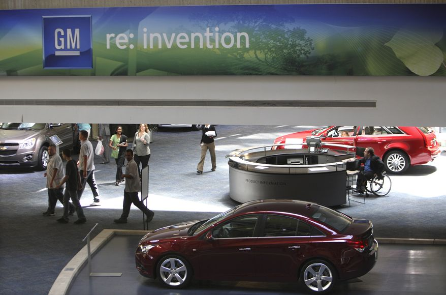 ** FILE ** General Motors vehicles are displayed at the GM headquarters in Detroit on Thursday, July 9, 2009. (AP Photo/Carlos Osorio)