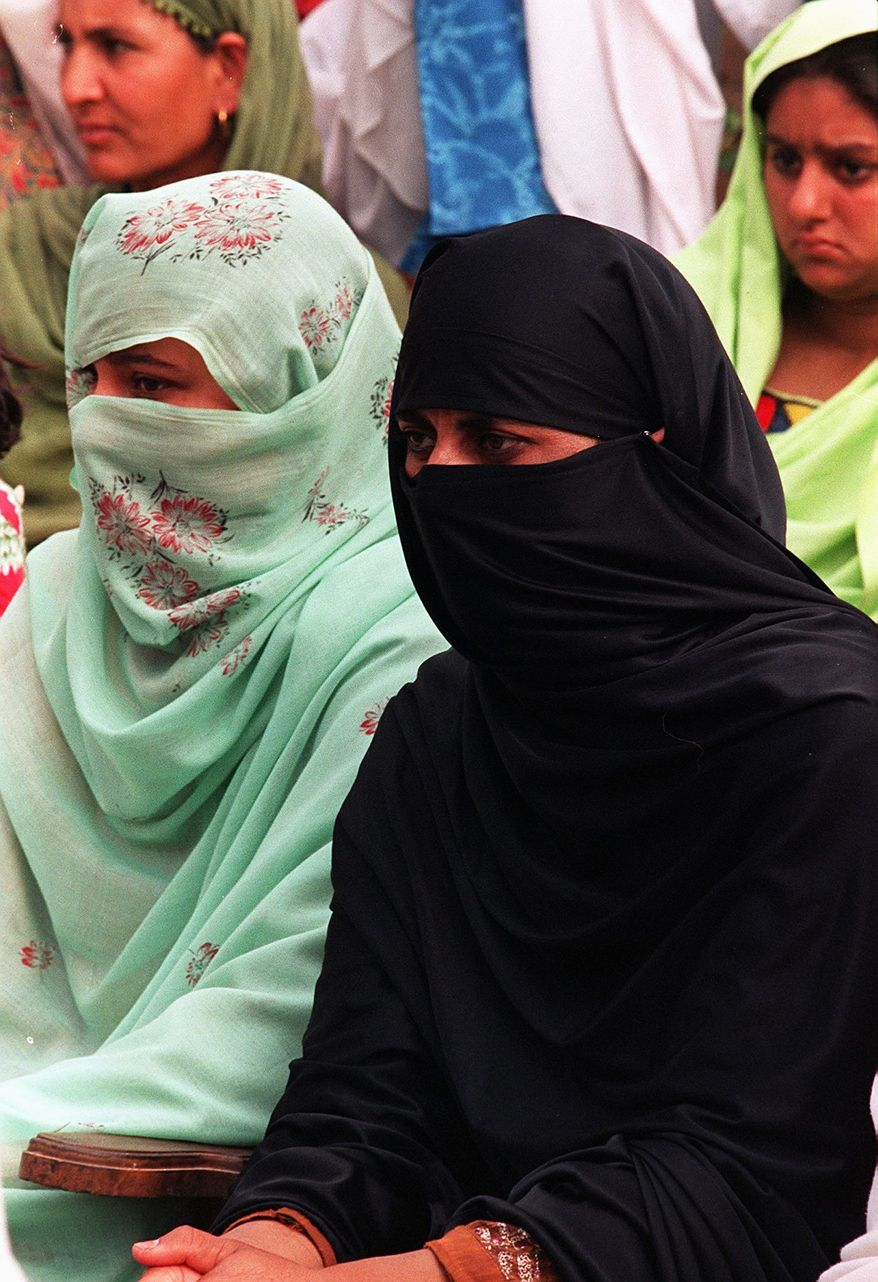 GETTY IMAGES Veiling of women is a hallmark of strict versions of Islam under Shariah law.