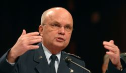 In this July 11, 2009, file photo, former CIA Director Michael V. Hayden says top members of Congress were kept well-informed about the Bush administration's post-9/11 surveillance program, with meetings that usually occurred at the White House with Vice President Dick Cheney in attendance. (Associated Press)