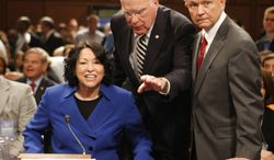 Supreme Court nominee Judge Sonia Sotomayor, accompanied by Senate Judiciary Committee Chairman Sen. Patrick Leahy, D-Vt., center, and the committee's ranking Republican Sen. Jeff Sessions, R-Ala., prepares to testify before the committee, Monday, July 13, 2009, on Capitol Hill in Washington. (AP Photo/Ron Edmonds)
