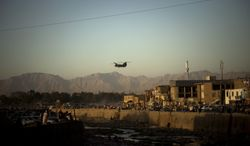 ** FILE ** An U.S. Chinook helicopter overflies Kabul, Afghanistan on Wednesday, July 15, 2009.  (AP Photo/Emilio Morenatti)