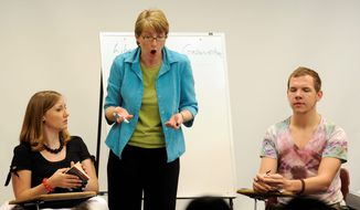"ASSOCIATED PRESS PHOTOGRAPHS ABOVE: Mallory Taul (center) teaches a ""mock"" class with students Paula Carter and Zackary Ruesler last month during a ""difficult dialogues"" summer workshop for campus leaders hosted by the University of Missouri at Columbia. RIGHT: Suzanne Burgoyne simulates an unpleasant classroom encounter between an evolution-denying student and an astronomy professor struggling to control her lecture."