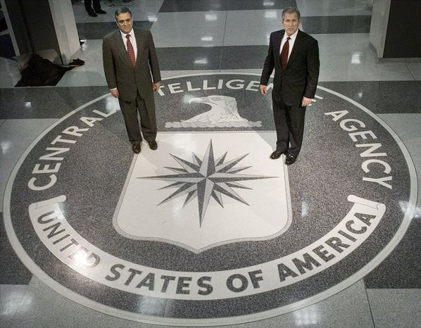 ** FILE ** On March 20, 2001, President George W. Bush (right) visits the Langley, Va., headquarters of the Central Intelligence Agency, where he thanked CIA employees for their service to their country and spoke of the importance of intelligence collection and analysis. At left is George J. Tenet, director of central intelligen
