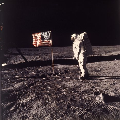 """** FILE ** In this July 20, 1969, photo, astronaut Edwin E. """"Buzz"""" Aldrin Jr. poses for a photograph beside the U.S. flag deployed on the moon dur"""