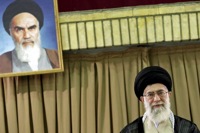 ** FILE ** This photo released by an official website of the Iranian supreme leader's office shows the supreme leader, Ayatollah Ali Khamenei, under a portrait of the late revolutionary Ayatollah Ruhollah Khomeini, during a meeting in Tehran in July 2009. (AP Photo/Office of the Supreme Leader)