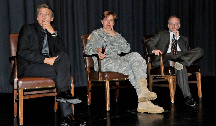 NOT THIS Jeremey Renner, actor; Brigadier General Loree Sutton, M.D., director of Defense Centers of Excellence for Psychological Health and Traumatic Brain Injury; and Brandon Millet, president of the GI Film Festival answer questions from audience at a screening of The Hurt Locker. (Photo by Renae Kleckner)
