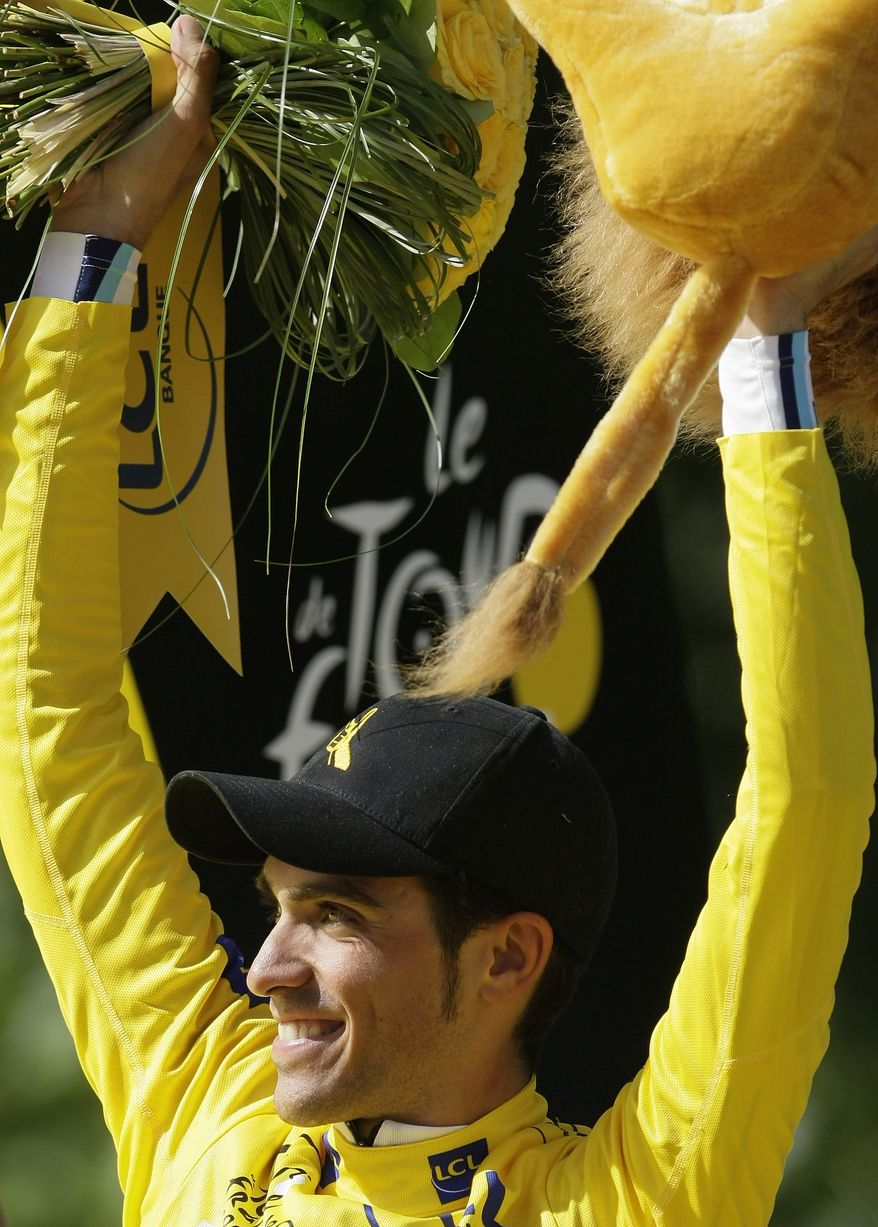Tour de France winner Alberto Contador of Spain, wearing the overall leader's yellow jersey, celebrates after winning the cycling race for the second time. (AP Photo/Laurent Rebours)