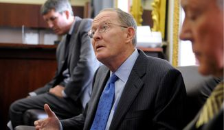 **FILE** Sen. Lamar Alexander, Tennessee Republican (The Washington Times)