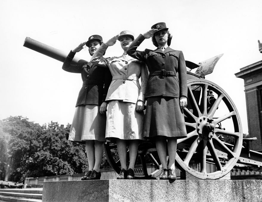 ** FILE ** U.S. Army service members salute in the official uniforms of the Women's Army Auxiliary Corps (WAACS) in this May 22, 1942, photo. Wartime often has been heralded as strong periods of American style, yet the wars in Afghanistan and Iraq seem to be barely a blip on the radar of the fashion community. (AP Photo/File)