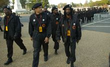 Members of the New Black Panther Party walk toward the U.S. Capitol for the Million More Movement rally to commemorate the 10th anniversary of the Million Man March on Oct. 15, 2005. (J.M. Eddins Jr./The Washington Times) ** FILE **