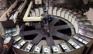Stacks of $1 bills are readied for shipment at the Bureau of Engraving and Printing in Washington. (AP Photo)
