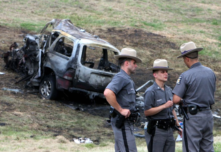 ** FILE ** New York state troopers investigate a fatal accident in which eight people were killed July 26 in Hawthorne, N.Y. A medical examiner found that the driver traveling the wrong way on the highway was legally drunk and high on marijuana.