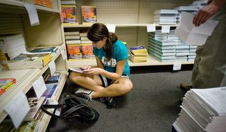 North Idaho College student Ashley Kelley shops for textbooks at the community college's bookstore in Coeur d'Alene, Idaho. (Associated Press)