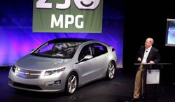 GETTY IMAGES General Motors CEO Fritz Henderson on Tuesday in Warren, Mich., previews the new Chevy Volt, which promises to get 230 miles per gallon in city driving. While the fuel economy is enticing, analysts say the $40,000 price tag would be daunting.