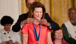 **FILE** Nancy Goodman Brinker, founder of Susan G. Komen for the Cure, is awarded the Medal of Freedom by President Obama during a ceremony at the White House on Aug. 12, 2009. (The Washington Times)