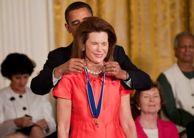 **FILE** Nancy Goodman Brinker, founder of Susan G. Komen for the Cure, is awarded the Medal of Freedom by President Obama during a ceremony at the White H