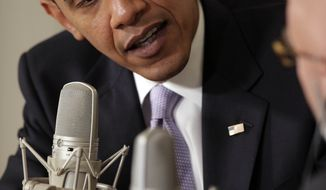 President Barack Obama speaks during a radio interview with Michael Smerconish in the Diplomatic Room at the White House in Washington Thursday, Aug. 20, 2009. (AP Photo/Alex Brandon)