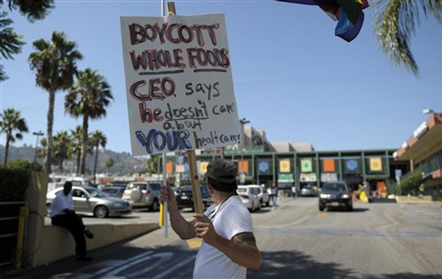 **FILE** Rick Watts, 49, protests outside a Whole Foods store in West Hollywood, Calif., on Aug. 23, 2009. The protest took place after John Mackey, the CEO of Whole Foods Market, wrote an op-ed piece for the Wall Street Journal about health care reform. (Associated Press)