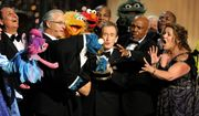 Cookie Monster (center) eats the statuette given for the Lifetime Achievement Award for 'Sesame Street' at the Daytime Emmy Awards on Sunday in Los Angeles.