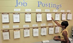 **FILE** Maureen Sanders looks for postings at the Employment Connection Wednesday, Sept. 2, 2009, in Parma, Ohio. (Associated Press)