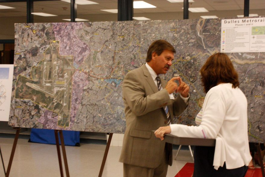 ** FILE ** Pat Nowakowski, executive director of the Dulles Corridor Metrorail Project, explains details of the plan at a meeting in 2009. He said he expects the project to make Dulles airport more competitive. (Ryan J. Reilly/Special to The Washington Times)