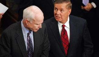** FILE ** Sen. John McCain (left) talks with Sen. Lindsay Graham in 2009. (The Washington Times)