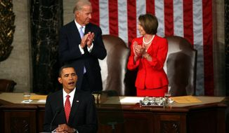 Vice-President Joseph Biden and Speaker of the House Nancy Pelosi, D-Calif., watch as President Barack Obama delivers a speech about health care reform to a joint session of Congress. 