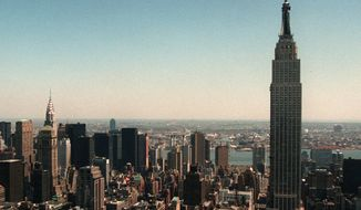 **FILE** The Empire State Building (right) towers over the New York skyline. (Associated Press)