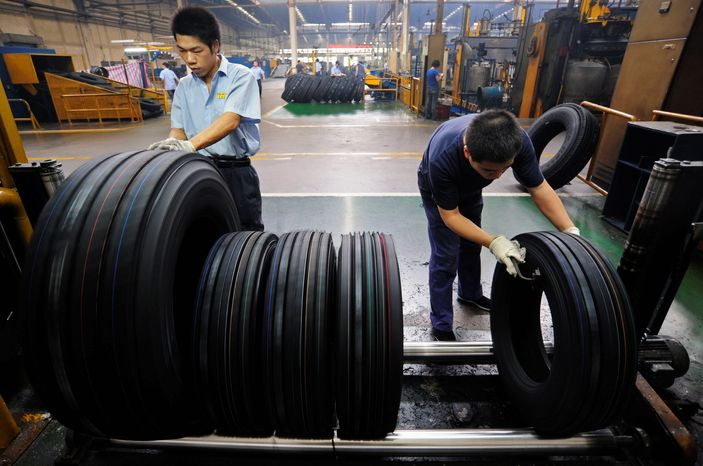 **FILE** Employees work at a tire factory in Hefei, in central China's Anhui province, on Sept. 16, 2009. (Associated Press)