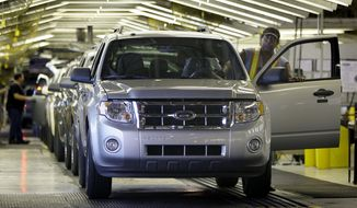 ** FILE ** In this Aug. 26, 2009, photo, new Escape SUVs roll off the line at Ford's Kansas City Assembly Plant in Claycomo, Mo. (AP Photo/Charlie Riedel)