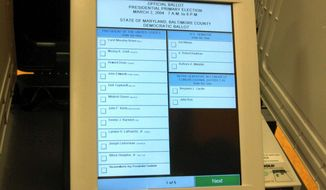 The pending merger of electronic voting machine companies has triggered concerns that voter fraud will increase if one company has too much control. (Associated Press)